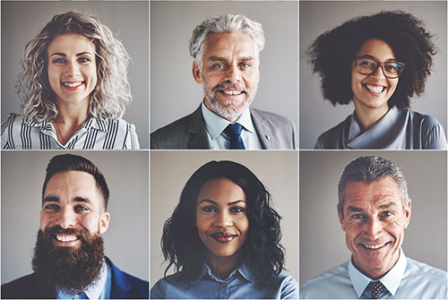 The photo shows a group of smiling business anthropologists in a modern corporate culture.