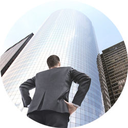 The photo shows a man looking at a building. He is responsible for a Excellent Onboarding – Merger & Acquisition's Secret Weapon